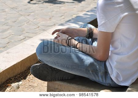Young Boy Sitting In The Street