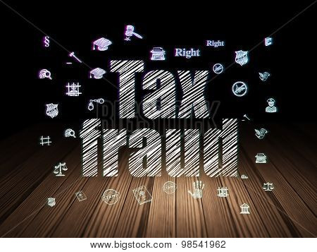 Law concept: Tax Fraud in grunge dark room