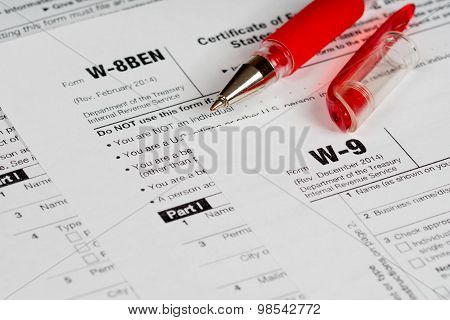 Tax Reporting Forms With Red Pen