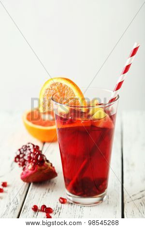 Glass Of Sandria On White Wooden Background