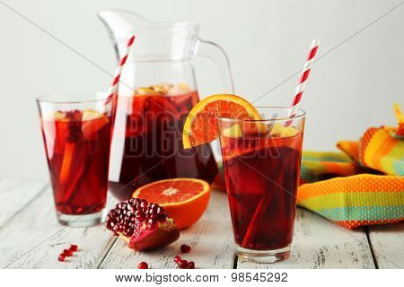 Jug Ang Glass Of Sandria On White Wooden Background