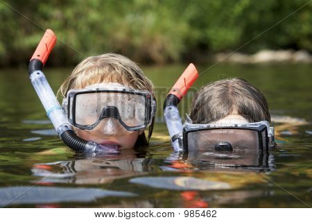 Two Kids Playing In The Water