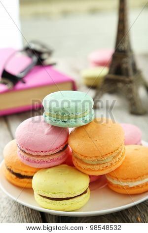 French Colorful Macarons On Plate On Grey Wooden Background