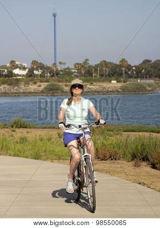 A Woman Bikes Fiesta Island, Mission Bay, San Diego