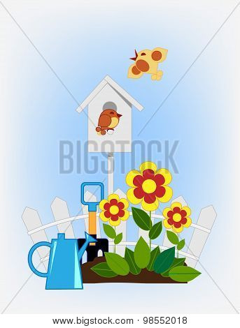 flower beds in the garden and birdhouse
