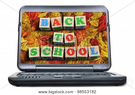 Laptop with autumn leaves screen. Back to school concept
