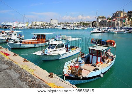 Old fishing boats and yachts in Heraklion port, Crete, Greece