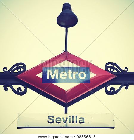 Metro sign in Madrid, Seville station. Instagram style filtered image