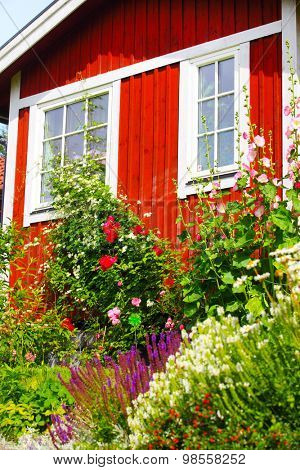 summer cottage with flower in the garden