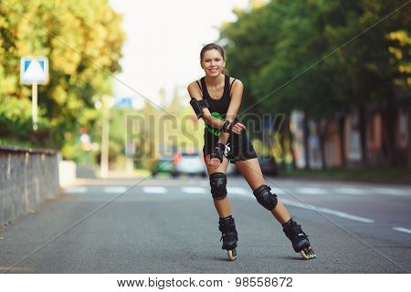 Cheerful girl on roller skates