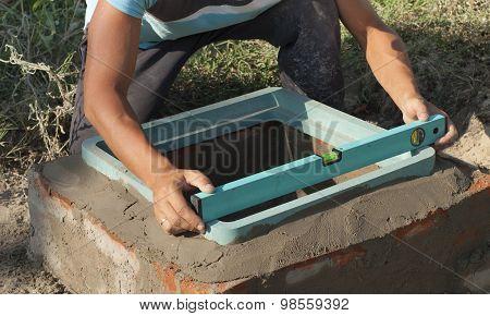 Installing Sewer Manhole