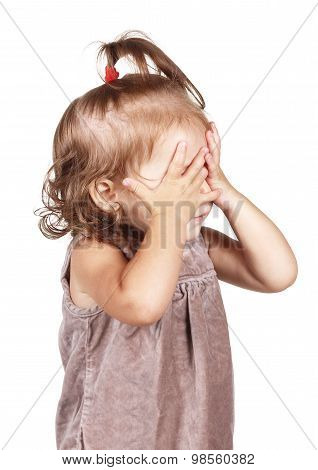Little Girl Hide Face Under Hands, Isolated On White