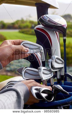 golfer choosing best club in bag