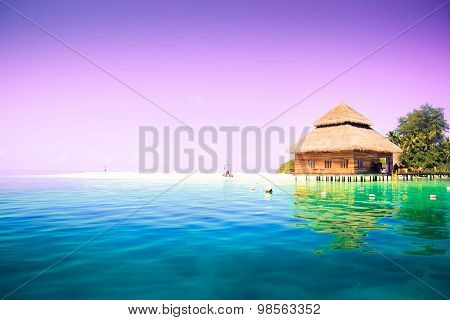 Overwater bungalows on the tropical island resort of Maldives at night