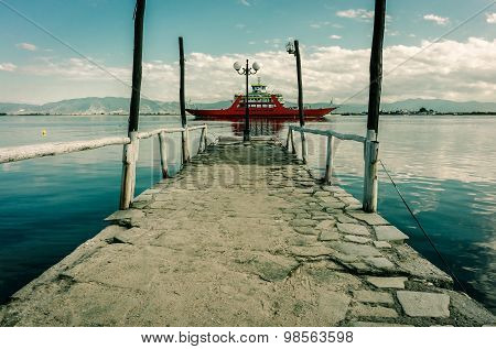 Small Stone Pier And Ferry At Mediterranean Lagoon