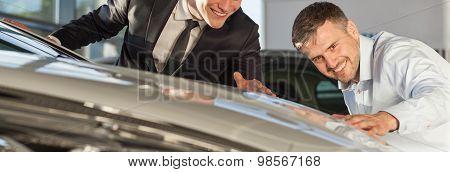 Men Admiring New Shiny Car