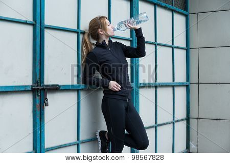 Runner Holding A Bottle