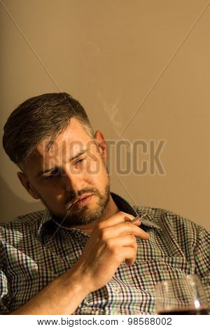 Drunk Businessman Smoking A Cigarette