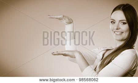 Smiling Woman Holding Open Palm Empty Hand