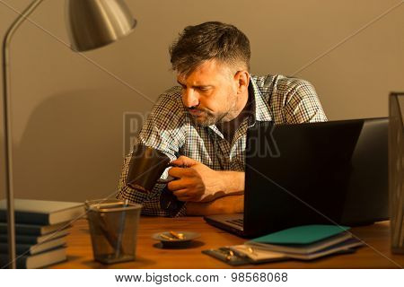 Man Sitting At The Desk