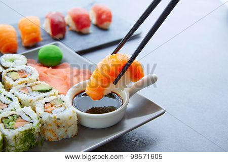Sushi Maki and Niguiri with soy sauce and wasabi with California Roll