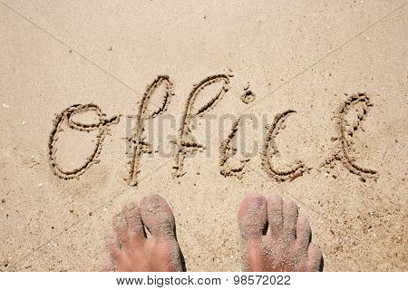 Concept or conceptual office handwritten in sand for business, natural, symbol, tourism or conceptual designs background with feet