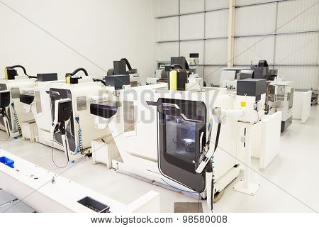 View Of Empty Engineering Workshop With CNC Machines