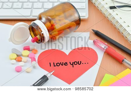 Health Care Concept - Supplement With I Love You Note On Red Heart Paper