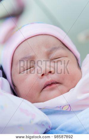 Portrait Of Cute Newborn Baby Girl