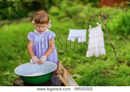 Little Helper Girl Washes Clothes In  Basin Outside