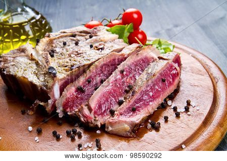 Grilled Sliced Meat Fillet On Wooden Background
