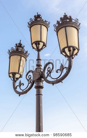The Classic Elegant Street Lampposts With Blue Sky Background.