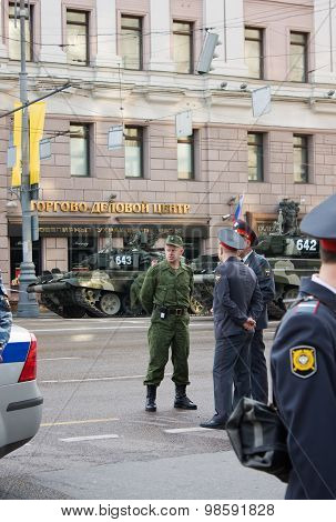 Police And Military Men Near The T-90 Tank On Parade Of Victory Day On May 9, 2010 In Moscow