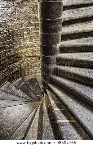 Vintage Old Spiral Stone Staircase In The Style Of Grunge