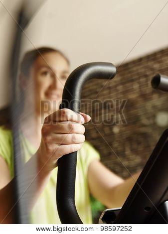 Woman Training Indoor, Elliptical Trainer