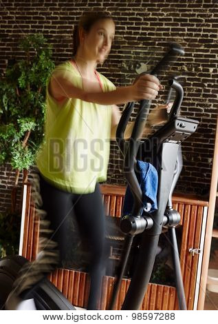 Woman Training Indoor, Elliptical Trainer