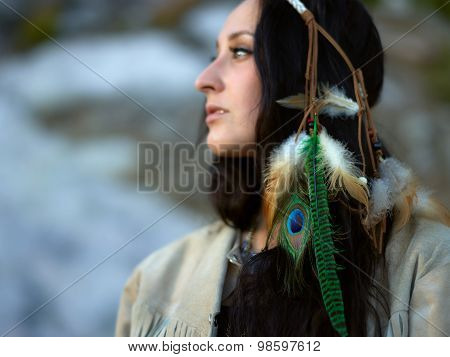 Attractive Young Woman And Feather Headpiece