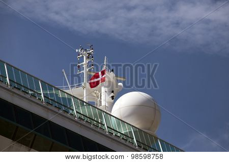 Ship Detail And Flag Under Blue Sky