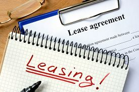 image of rental agreement  - Notepad with leasing and lease agreement form - JPG