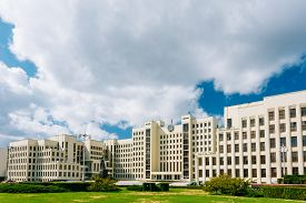 stock photo of lenin  - White Government Parliament Building And Lenin Statue on Independence Square in Minsk - JPG