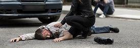 stock photo of street-walker  - Car hit deadly young man on street - JPG