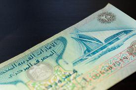 foto of dirham  - Banknote in twenty dirhams of the United Arab Emirates close up - JPG