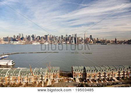 Town Houses with the Hudson River and Mid-Town Manhattan in background.