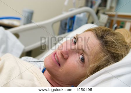 Sick Patient In Hospital Bed
