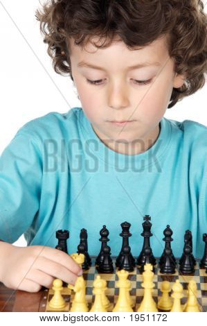 Boy Playing The Chess