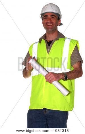 Smiling Construction Worker With An Architectural Plans