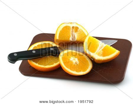Slices Of An Orange And Knife