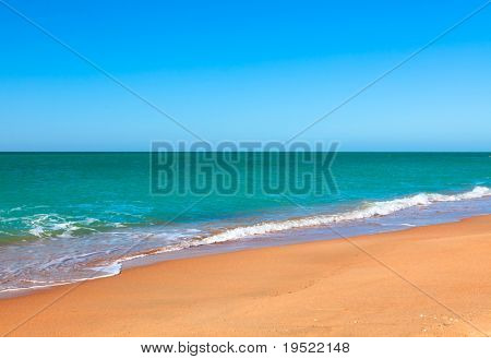 Sandy beach of seaside resort with clear water