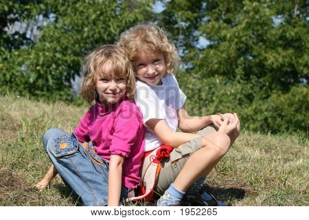 Two Daughters Sitting