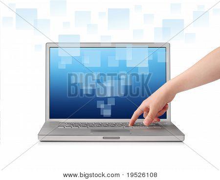 Finger pressing key on laptop